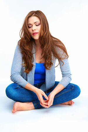 Casual style young woman sitting on white floor. Female mode full body portrait.l.