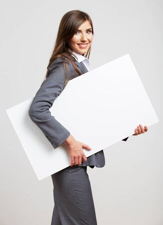 Smile Business woman portrait with blank white board on gray isolated . Female model with long hair.