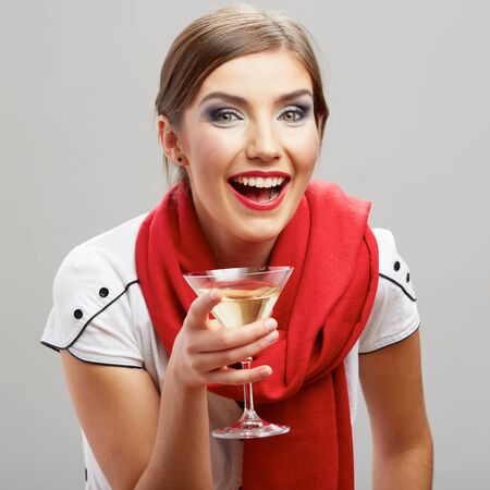 Beautiful smiling woman with wine glass . studio isolated .