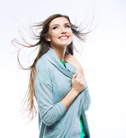 Casual style woman with motion hair, isolated portrait.