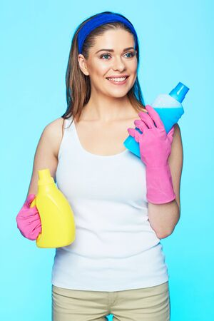 Woman chooses chemistry for cleaning house. Isolated smiling woman.