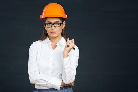 Smilind business builder woman portrait on black. Banco de Imagens