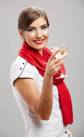 Young beautiful celebrate woman drink wine. Smiling female model holiday portrait against isolated studio background. Big toothy smile. Stockfoto - 129803382
