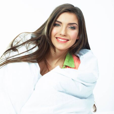 Woman bed portrait. Female model lying in bed. Close up smiling face .