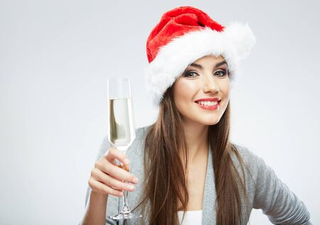 Christmas Santa hat isolated woman portrait hold wine glass . Smiling happy girl on white background.