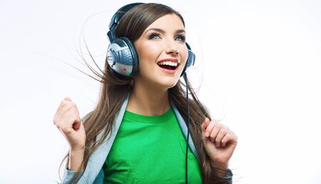 Young motion woman with headphones listening music .Music teenager girl dancing against isolated white background. Beautiful female model. Stock fotó