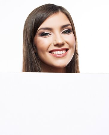 White banner . Student girl hold white blank paper. Young smiling woman show blank board. Close up female model face, portrait isolated on white background. Stock fotó