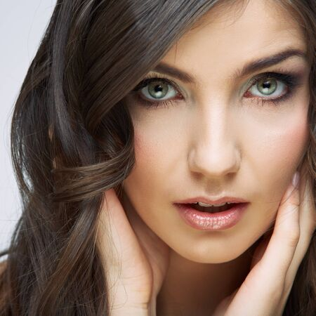 Woman beautiful face portrait. Skin care style face hand touching. Female model studio posing. Stock fotó