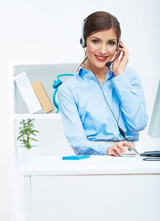 Portrait of woman customer service worker, call center smiling operator with phone headset. Young female business model. Stockfoto