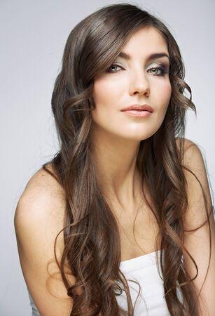 Hair style young woman portrait.Female model studio posing.