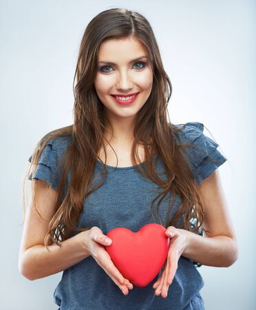 Heart. Love symbol. Portrait of beautiful woman hold Valentine day symbol. Isolated studio background female model. Beautiful girl.