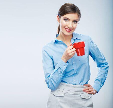 Business woman portrait hold red coffee cup. Female model drink tea. Фото со стока