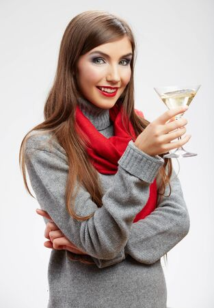 Woman winter style casual clothes portrait. Smiling model with drink in glass isolated on white background Stockfoto