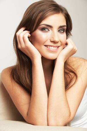 Portrait of smiling woman sitting on sofa. Casual style home shoot. Stock Photo