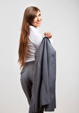 Portrait of young  smiling business woman, isolated. Turned back.