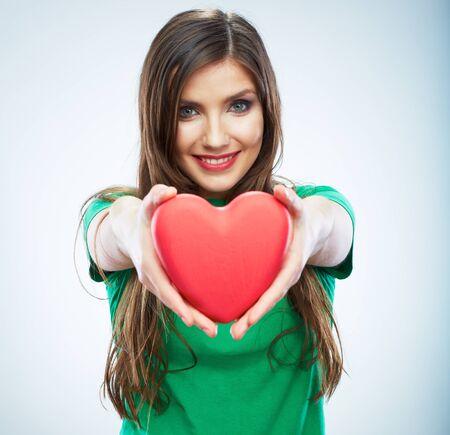 Heart. Love symbol. Portrait of beautiful woman hold Valentine day symbol. Isolated studio background female model. Beautiful girl.
