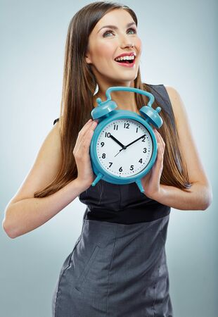 Portrait of business woman holding watch. Business time concept. Stock Photo