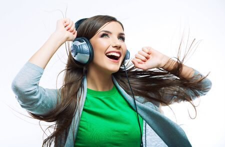 Woman with headphones listening music .Music teenager girl dancing against isolated white background Reklamní fotografie - 130071893