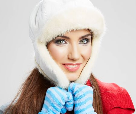 Winter style woman close up portrait isolated.