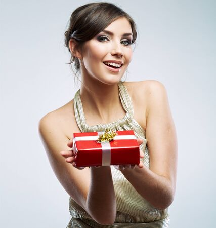 Beautiful woman portrait hold gift in christmas color style . Smiling happy girl on white background.
