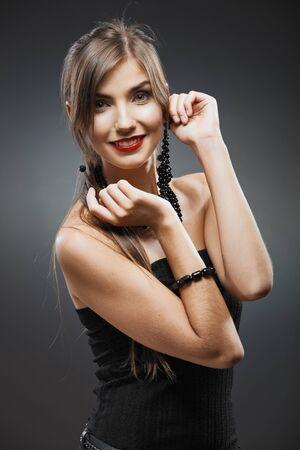 Woman fashion beauty close up portrait. Evening black dress. Stock Photo