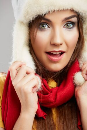 Portrait of a beautiful smiling woman red winter scarf dressed. Stock Photo
