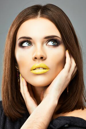 Woman face. Beauty portrait with yellow lips, long hair. Stockfoto
