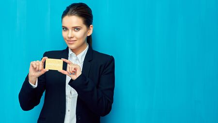 Gold payment credit card for confident. Business woman in black suit. Stockfoto