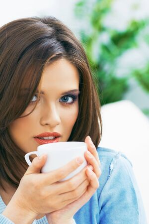 Woman coffee drink portrait. Young model. Stockfoto