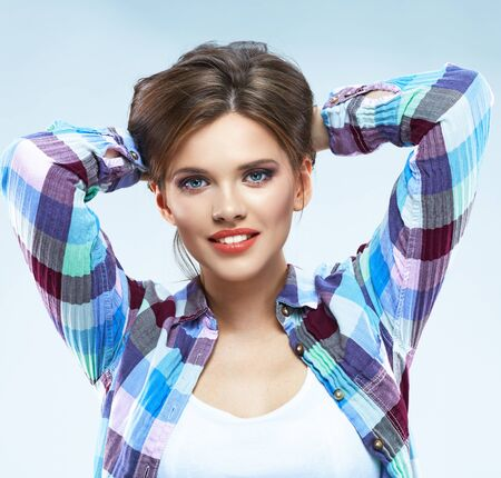 Hipster style woman. Young woman with beautiful smile. Isolated portrait. Casual style. Stockfoto