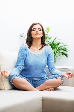 Woman sitting in yoga pose. Young model. Healthy life.