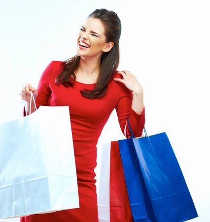 Shopping woman portrait isolated. White background. Happy shopping girl. Red dress. female beautiful model. Stockfoto