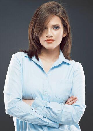 Young business woman portrait. Studio portrait. Crossed arms. Stock Photo
