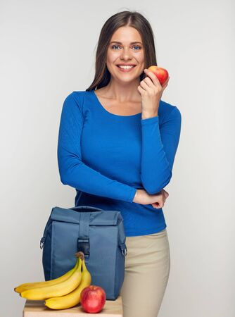 Young woman lunch bag with vegetables. Isolated studio portrait. Zdjęcie Seryjne