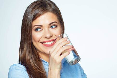 Smiling business woman drink water. White background. Isolated portrait.