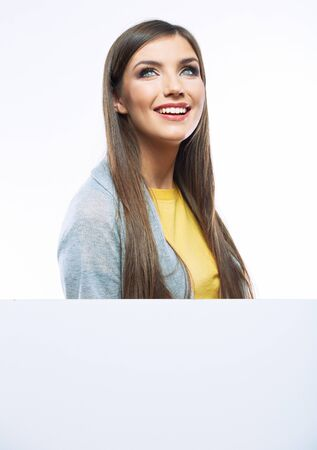 Teenager girl with white blank board. White background isolated portrait of smiling young woman.