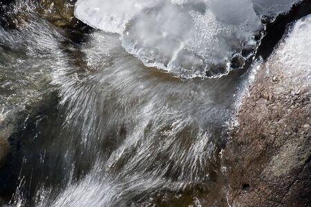 cascade: mountain river with ice cascade