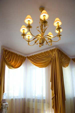 electric material: chandelier in luxury house. interior of the house