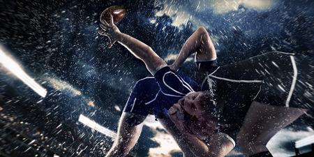 conflicto: jugadores de competición de rugby en la lluvia