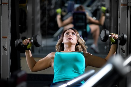 muscle girl: Portrait of young female training in gym Stock Photo