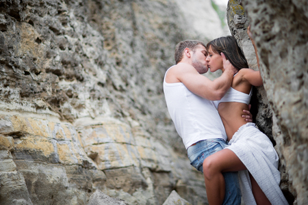 interracial love: Happy Young Couple lovers man and woman walking in the mountains
