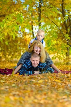 happy family nature: love, relationship, family, leisure, autumn - Happy family walking at the autumn nature Stock Photo