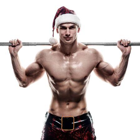 seks: Feestdagen en vieringen, Nieuwjaar, Kerstmis, sport, bodybuilding, gezonde levensstijl - gespierde knappe sexy kerstman Stockfoto