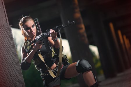 gunshot: sexy military armed girl with the weapon
