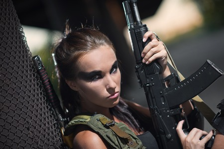 armed: sexy military armed girl with the weapon