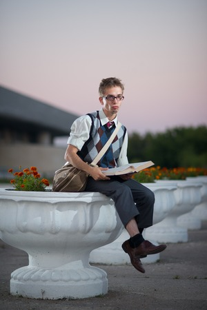 young fellow: a young fellow student, a geek, a nerd, with glasses and a book
