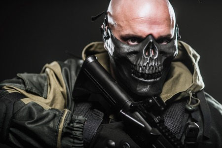 bombing: Military, war, conflict, soldiers - a military man in a black mask on a dark background.