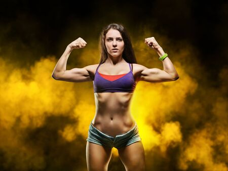 body workout, yoga and fitness - a beautiful young sporty woman showing muscle Stock Photo