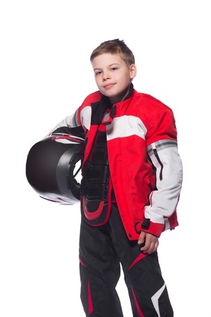 Race car or bike driver. The boy in the costume of the racer holding a helmet and looking at the camera isolated on white background 版權商用圖片