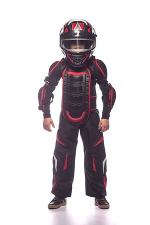 protective suit: Race car or bike driver. The boy in the costume of the racer holding a helmet and looking at the camera isolated on white background Stock Photo